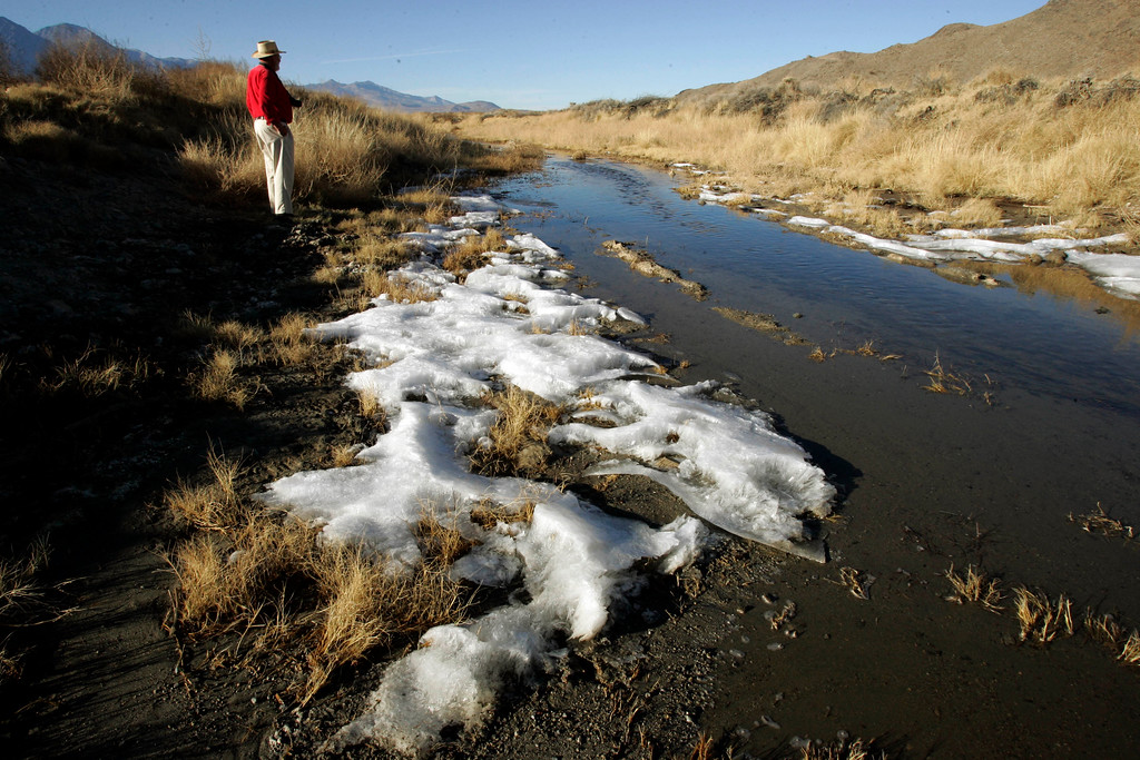 . Frank Colver of Newport Beach, Calif., views a section of the Owens River, near Independence, Calif., Wednesday, Dec. 6, 2006.  (AP Photo/Reed Saxon)