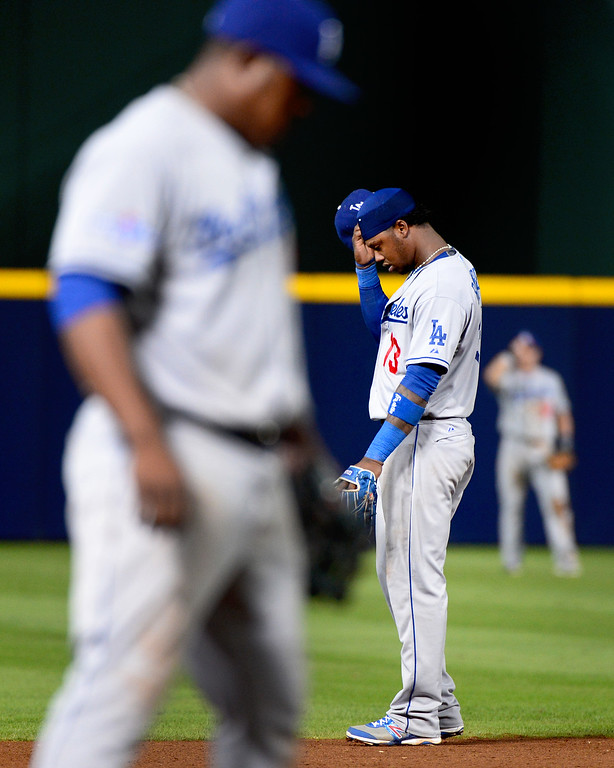 . Los Angeles Dodgers\' Hanley Ramirez takes a moment in the ninth as the Atlanta Braves defeat the Dodgers 4-3 in game 2 of the playoffs Thursday, October 4, 2013 at Turner Field in Atlanta, Georgia. (Photo by Sarah Reingewirtz/Pasadena Star- News)