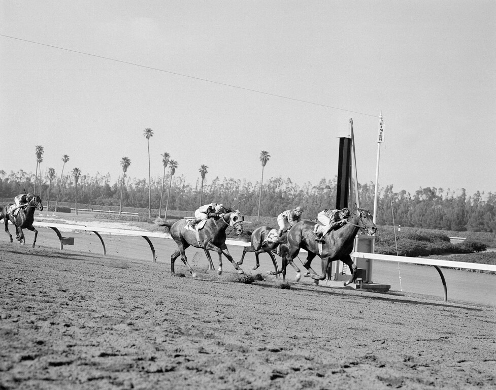 . Swaps, 1955 Kentucky Derby winners, wins the $109,800 California in world record time of 1:45 2/5 for the mile and one-sixteenth race at Hollywood Park in Inglewood, California  June 11, 1955. A length and quarter behind was another Kentucky Derby Winner, Determine, left. Mister Gus, the pace-setter, was third. The California-bred three-year-old clipped two-fifths of a second of the world record set last year by Poona at Santa Anita. (AP Photo/Harold P. Matosina )