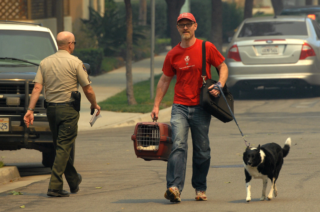 . Cal State University Channel Islands sociology teacher Dennis Downey evacuates with his pets Thursday, May 2, 2013. (Michael Owen Baker/Los Angeles Daily News)