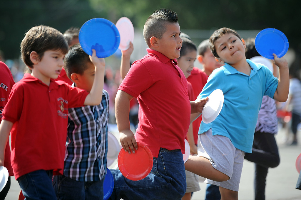 . Students perform a dance during the Canoga Park Elementary School Centennial Celebration May 17, 2013.  Live musicians, performances by students, an LAPD helicopter flyover and speakers were featured during the event in Canoga Park, CA Friday.(Andy Holzman/Staff Photographer)