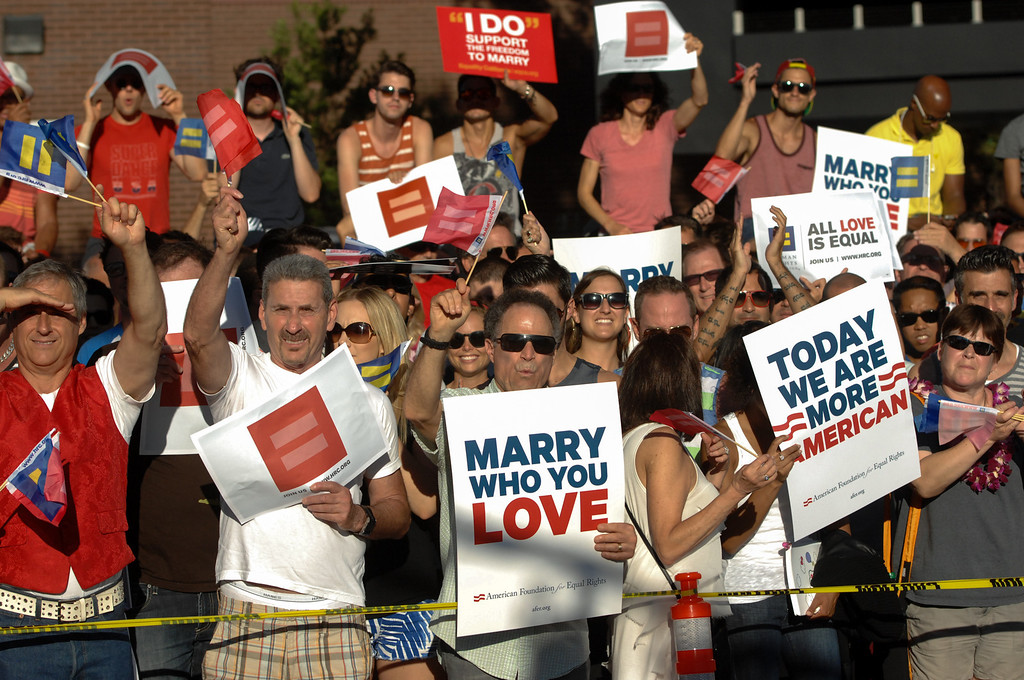 . People attend the rally in West Hollywood to celebrate the U.S. Supreme Court\'s ruling that killed Prop 8, Wednesday, June 26, 2013. (Michael Owen Baker/L.A. Daily News)