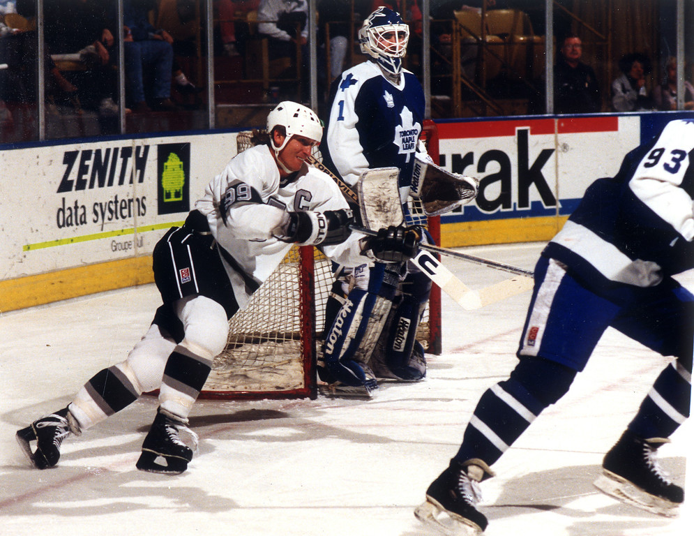 . Kings Wayne Gretzky tries to prevent Alexander Godynyuk from clearing the puck on March 20, 1991.  L.A. Daily News file photo