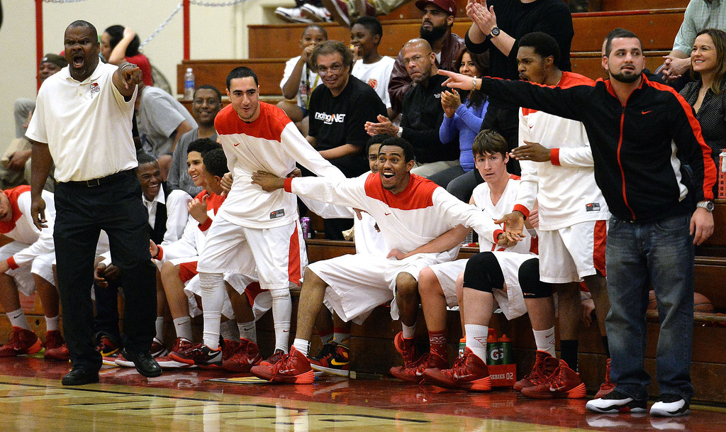 . Pasadena\'s bench reacts after a basket against Ontario in the first half of a prep playoff game at Pasadena High School in Pasadena, Calif., on Friday, Feb.21, 2014. (Keith Birmingham Pasadena Star-News)