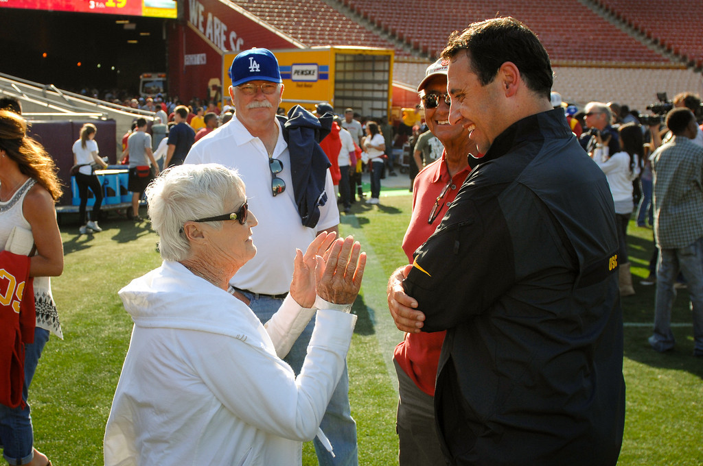 . USC head coach Steve Sarkisian talks with mother Sally Sarkisian following the spring game. (Photo by Michael Owen Baker/L.A. Daily News)