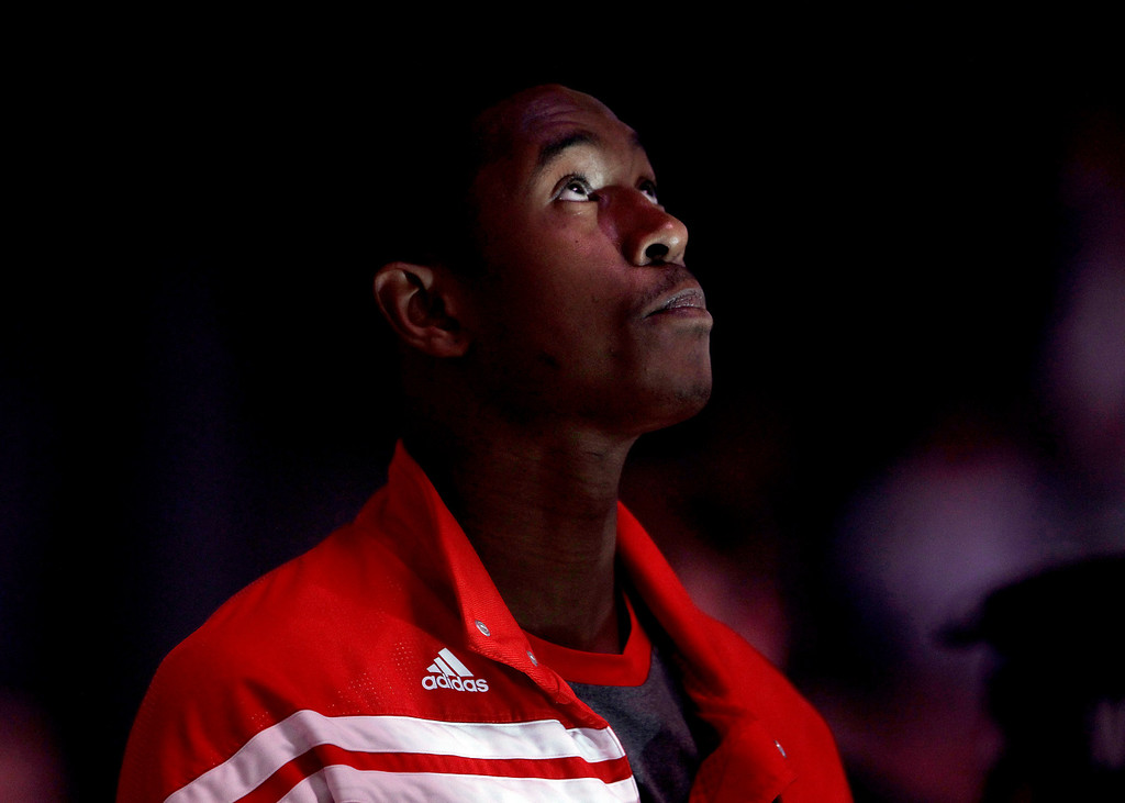 . New Jersey Nets\' MarShon Brooks looks up during the national anthem prior to the start of an NBA basketball game against the Philadelphia 76ers, Monday, April 23, 2012, in Newark, N.J. (AP Photo/Julio Cortez)
