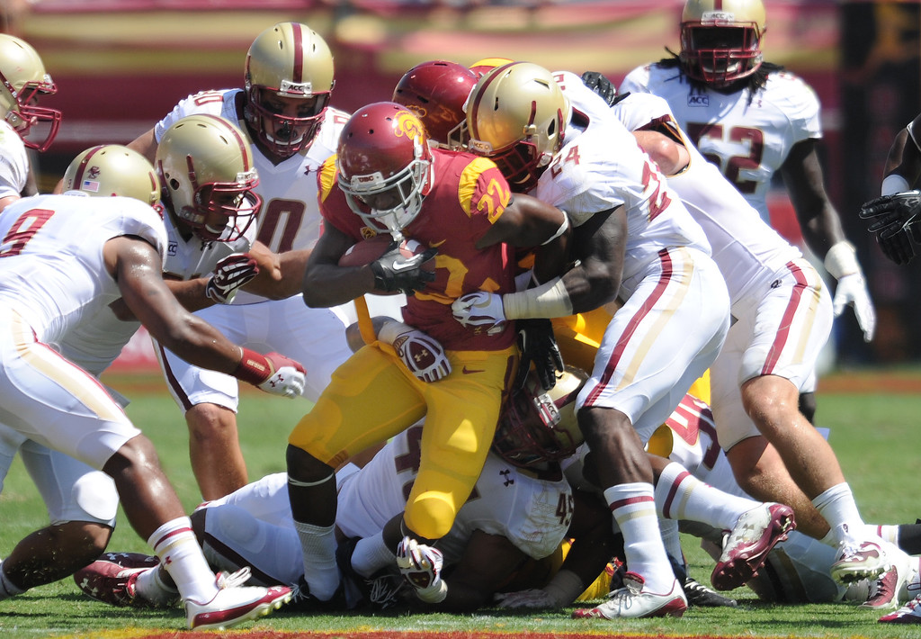 . USC #22 Justin Davis is brought down in the 2nd quarter. USC Plays Boston College at the Coliseum in Los Angeles, CA. 9/14/2013. photo by (John McCoy/Los Angeles Daily News)