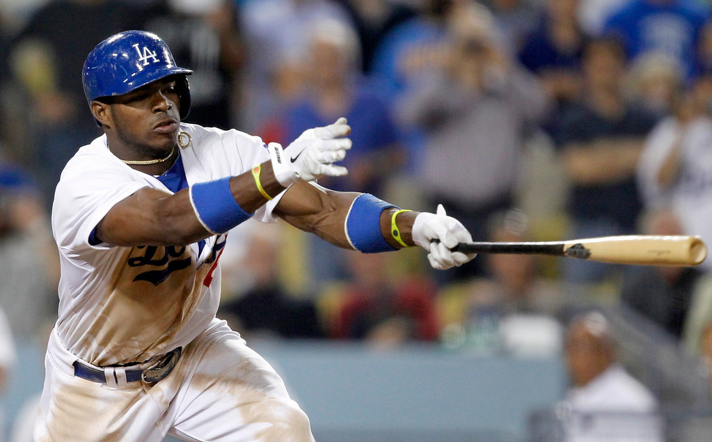 . Los Angeles Dodgers\' Yasiel Puig hits a two-RBI single against the Philadelphia Phillies in the eighth inning during a baseball game Thursday, June 27, 2013, in Los Angeles.   Dodgers won 6-4.   (AP Photo/Alex Gallardo)