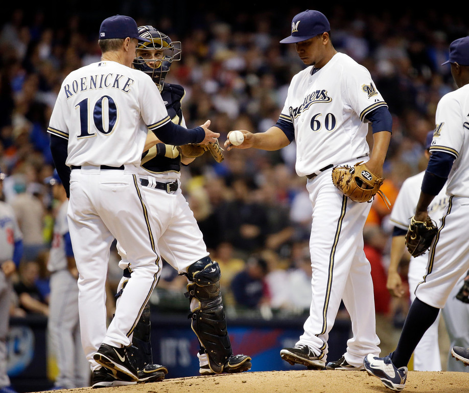 . Milwaukee Brewers manager Ron Roenicke takes starting pitcher Wily Peralta (60) out of the game during the second inning of a baseball game against the Los Angeles Dodgers Wednesday, May 22, 2013, in Milwaukee. (AP Photo/Morry Gash)