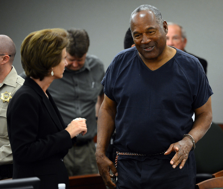 . O. J. Simpson, right,  talks to his defense attorney Patricia Palm during a break on the second day of an evidentiary hearing for Simpson in Clark County District Court, Tuesday, May 14, 2013 in Las Vegas.  The hearing is aimed at proving Simpson\'s trial lawyer, Yale Galanter,  had conflicted interests and shouldn\'t have handled Simpson\'s case. Simpson is serving nine to 33 years in prison for his 2008 conviction in the armed robbery of two sports memorabilia dealers in a Las Vegas hotel room.  (AP Photo/Ethan Miller, Pool)