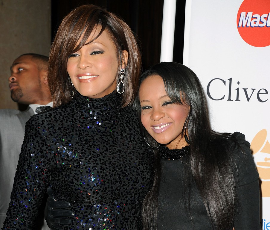 . Singer Whitney Houston (L) and Bobbi Kristina Brown arrives at the 2011 Pre-GRAMMY Gala and Salute To Industry Icons Honoring David Geffen at Beverly Hilton on February 12, 2011 in Beverly Hills, California.  (Photo by Jason Merritt/Getty Images)