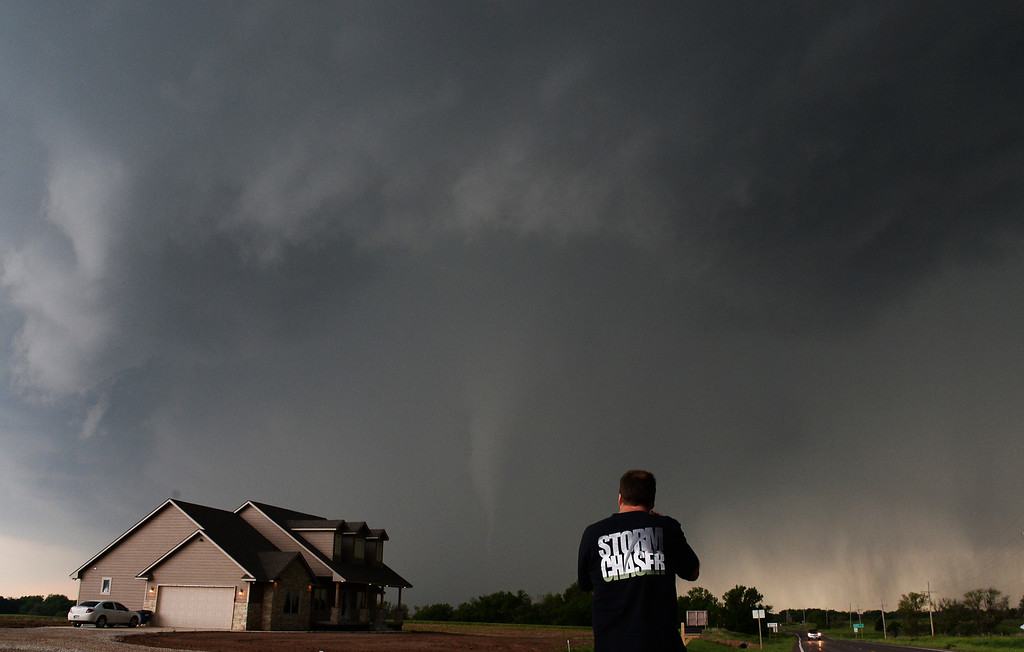 . Storm chaser video photographer Brad Mack gets close to a tornado near a home in South Haven Sunday May 19th in Kansas.  The tornadoes that touched down in Oklahoma and Kansas and Iowa were part of a massive, northeastward-moving storm system that stretched from Texas to Minnesota. At least four separate tornadoes touched down in central Oklahoma late Sunday afternoon, including the one near the town of Shawnee were one person was killed 35 miles southeast of Oklahoma City. May 19.2013. South Haven Kansas. Photo by Gene Blevins/LA Daily News