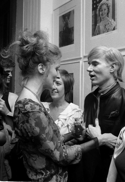 . Underground filmmaker Andy Warhol, right, is seen with his superstar, Viva, during a party at this studio in New York, Sept. 19, 1968.  Others are unidentified. (AP Photo/Marty Lederhandler)
