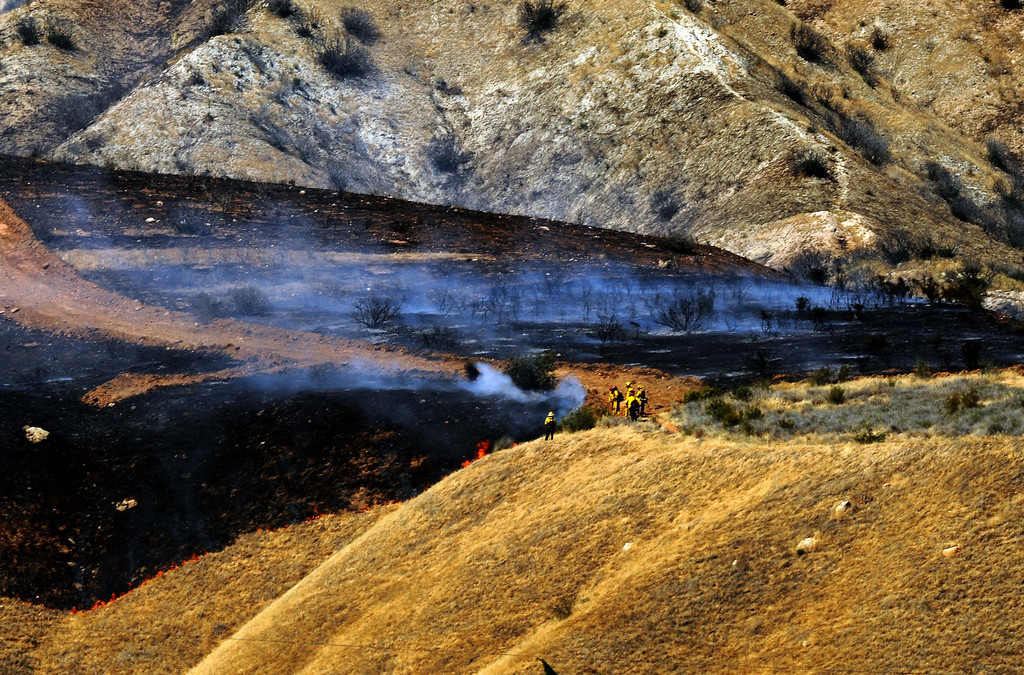 . Firefighters  battle a 3,000 acres Summit Fire that\'s burning along Sunset Avenue in Banning May 1, 2013. The fire is only 35% contained. Strike teams and crews from a number of fire agencies including San Bernardino County Fire, Los Angeles County Fire, Orange County Fire, Cal Fire, Chino Valley Fire, Rancho Cucamonga Fire and San Antonio Heights Fire  responded to the blaze which caused evacuations.LaFonzo Carter/ Staff Photographer