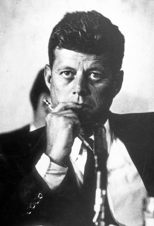. John F. Kennedy during a thoughtful moment.