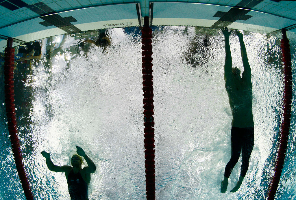 . Michael Phelps of the US, right, reaches out to touch the wall ahead of Australia\'s  Andrew Lauterstein during his butterfly leg of the men\'s medley relay at the swimming competitions in the National Aquatics Center at the Beijing 2008 Olympics in Beijing, Sunday, Aug. 17, 2008. (AP Photo/Mark J. Terrill)