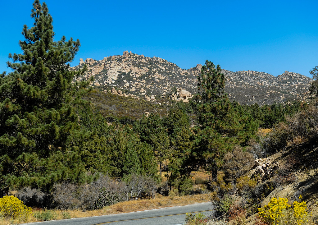 . View of the Pinnacle Peaks from a distance along Highway 173 as efforts to find a missing German hiker continue in the San Bernardino Mountains near Lake Arrowhead on Friday, Oct. 4, 2013. Alyof Krost, 62, went missing Tuesday afternoon after hiking with a group of 20 people on the Pinnacle Trail near Lake Arrowhead. (Photo by Rachel Luna / San Bernardino Sun)