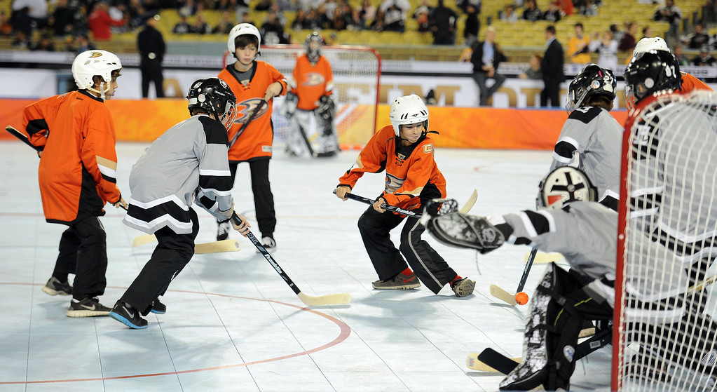 . A youth hockey match prior to the start of the inaugural NHL Stadium Series game between the Anaheim Ducks and the Los Angeles Kings at Dodger Stadium in Los Angeles on Saturday, Jan. 25, 2014. (Keith Birmingham Pasadena Star-News)