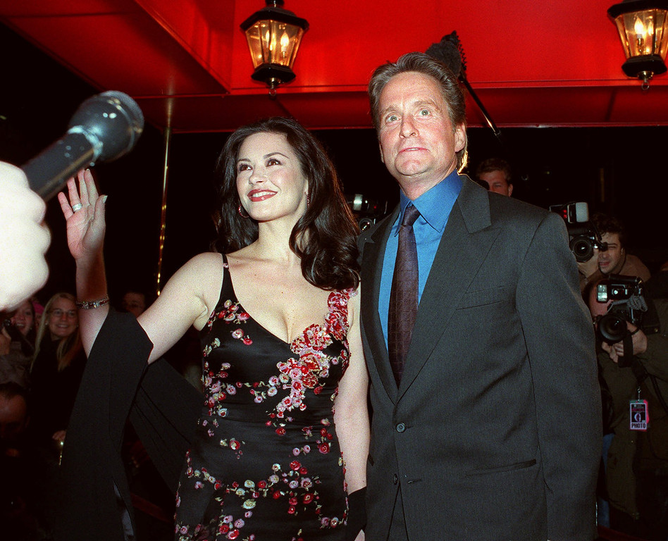 . Actor Michael Douglas, and his fiancee, actress Catherine Zeta-Jones, pose for photographers outside the Russian Tea Room Friday, Nov. 17, 2000, in New York. The couple will wed at New York\'s Plaza Hotel on Saturday, Nov. 18. (AP Photo/Mitch Jacobson)