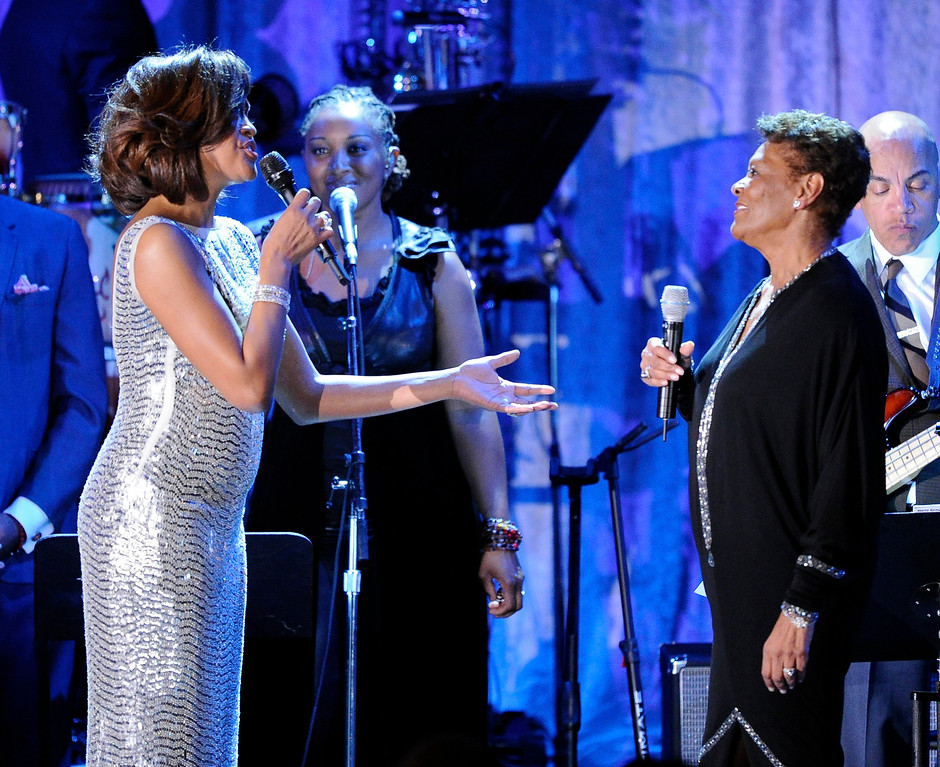 . Singer Whitney Houston, left, performs with Dionne Warwick at the pre-Grammy gala & salute to industry icons with Clive Davis honoring David Geffen, Sunday, Feb. 13, 2011, in Beverly Hills, Calif. (AP Photo/Mark J. Terrill)