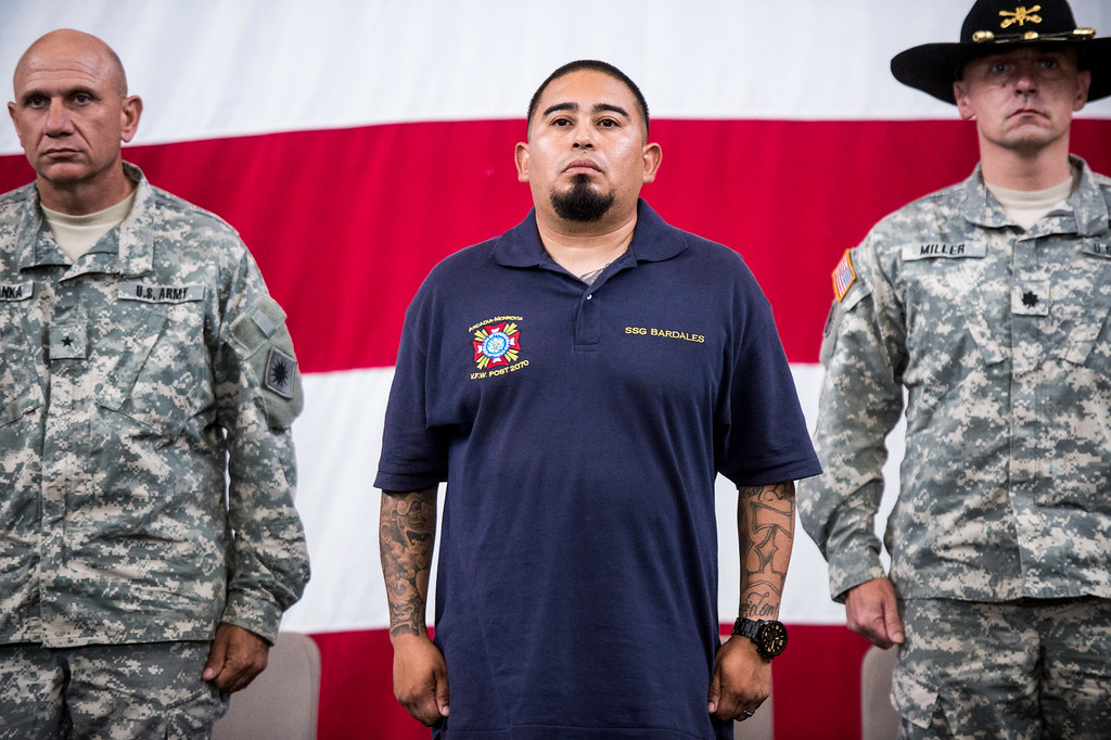 . Sgt. Luis Bardales, a resident of Irwindale who works for the city of South Pasadena, receives a Purple Heart at the Army National Guard in Azusa Saturday, July 12, 2014 while being flanked by Brig. Gen. Mark Malanka, left, and Lt. Col. Jesse Miller. Bardales was wounded by a roadside IED in Baghdad, Iraq and saved gunner Gabriel Herrera by pulling him out of their Humvee before another IED explosion. (Photo by Sarah Reingewirtz/Pasadena Star-News)