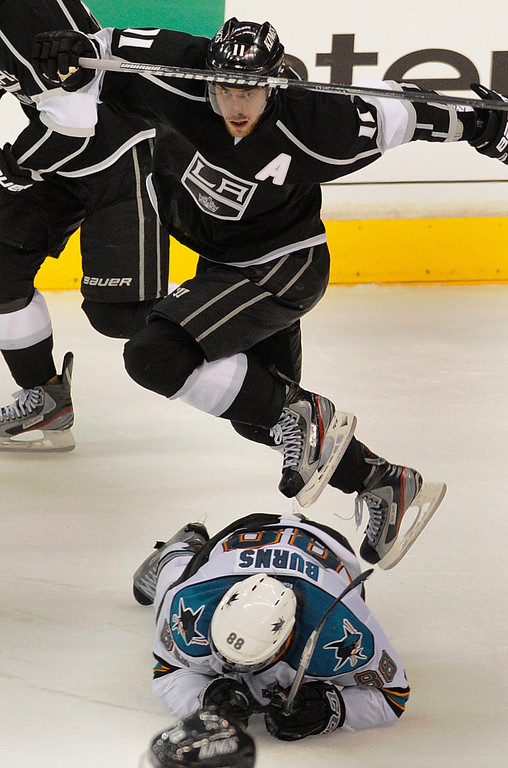 . Kings#11 Anze Kopitar leaps over Sharks#88 Brent Burns in the final seconds of the 3rd period. The Kings defeated the San Jose Sharks 2-0 in the first game of the Second Round of the Western Conference Playoffs. Los Angeles CA 5/14/2013(John McCoy/LA Daily News)