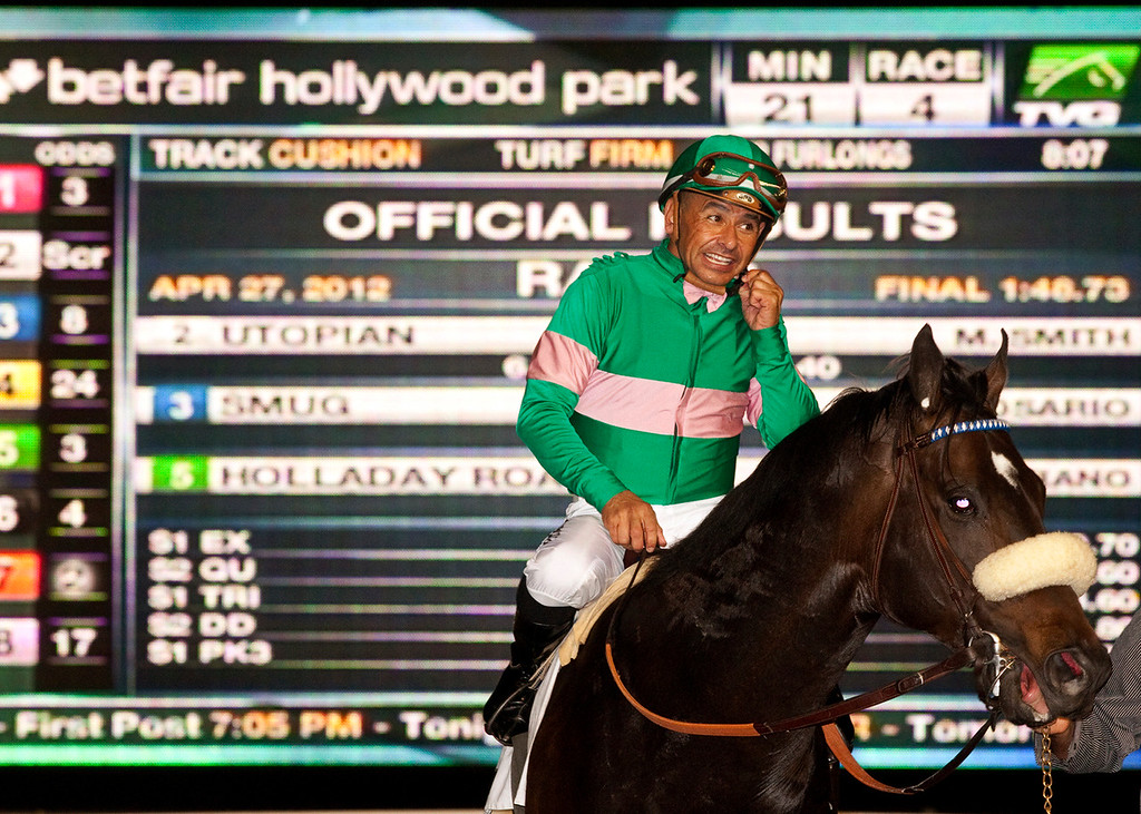 . In this photo provided by Benoit Photo, Utopian and jockey Mike Smith are guided to the winner\'s circle after their victory in the Grade III, $100,000 Inglewood Handicap horse race, Friday, April 27, 2012, at Betfair Hollywood Park in Inglewood, Calif. (AP Photo/Benoit Photo)