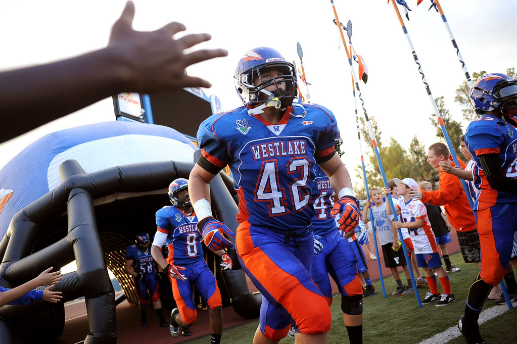 . The Westlake High football team takes the field for their first home game August 30, 2013 in Westlake Village, CA.(Andy Holzman/Los Angeles Daily News)