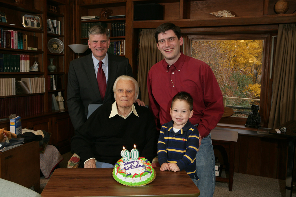 . In a handout photo provided by the family of Billy Graham, the famed evangelist celebrates his 90th birthday with his son Franklin, his grandson Will and great-grandson Quinn, in Montreat, N.C. on Friday, Nov. 7, 2008.  (AP Photo/ Courtesy of the Graham family)