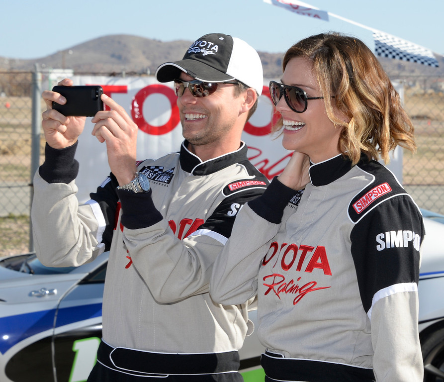 . March 15,2014. Rosamond CA. Actor Colin Egglesfield(L) and actress Tricia Helfer pose for photos, as celebrities in the Long Beach Grand Prix practice racing with instructors in Toyota race cars at the Willow Springs International Raceway.  photo by Gene Blevins/LA DailyNews