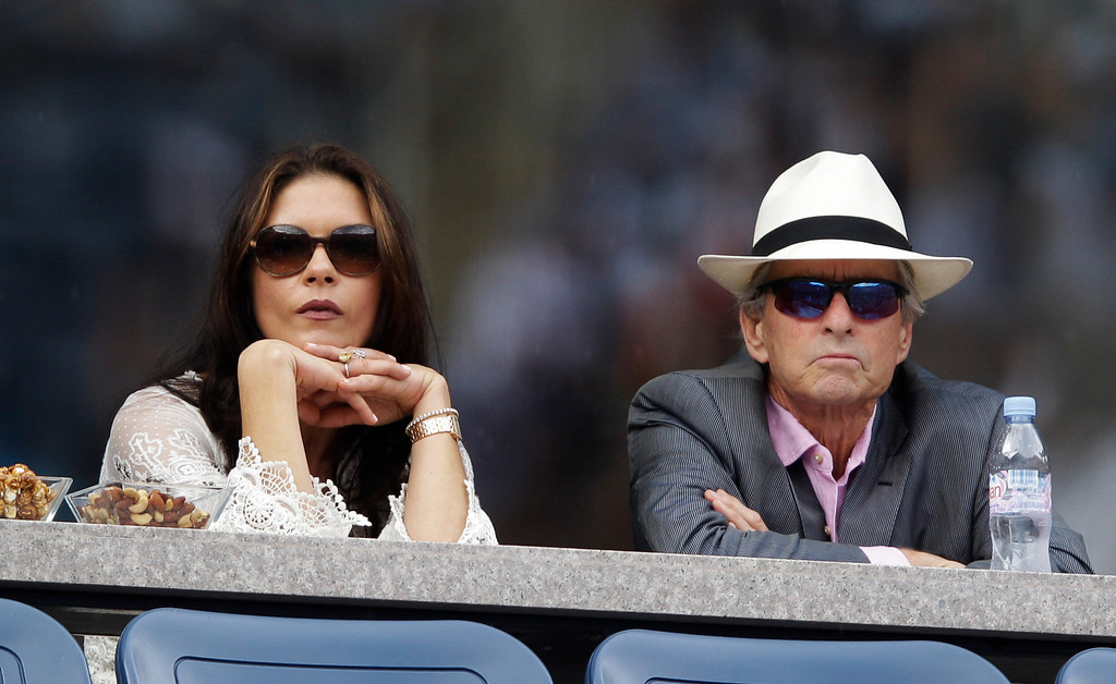 . Catherine Zeta-Jones, left, and Michael Douglas, right, look on before a semifinal match at the U.S. Open tennis tournament in New York, Saturday, Sept. 10, 2011. (AP Photo/Matt Slocum)