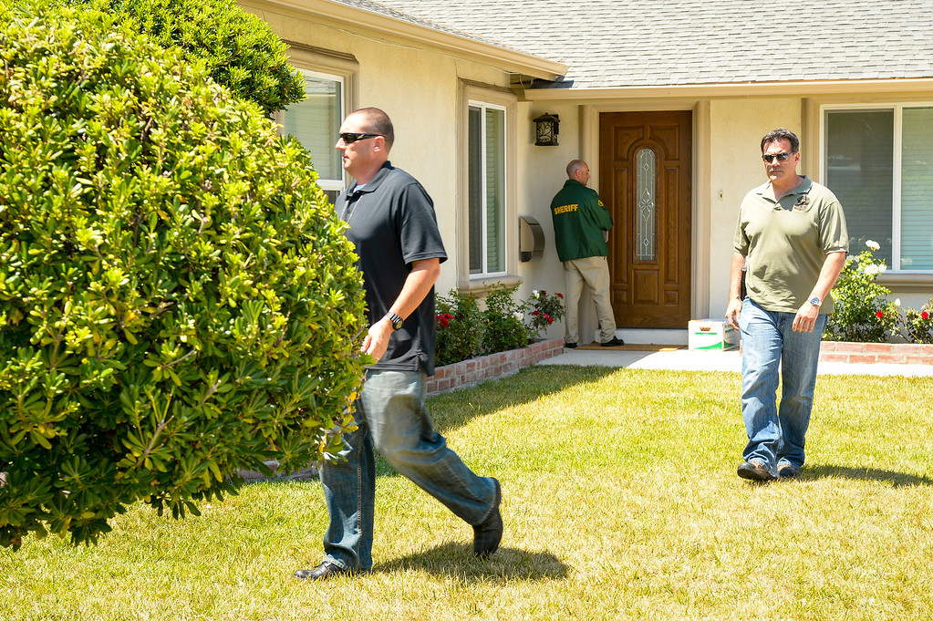 . A Santa Barbara County Sheriff and ATF members the home of Chin Rodger in the 23000 block of Windom street in West Hills, CA.  Rodger is the mother of Elliott Rodger who is suspected of killing 6 people Friday night in Isla Vista, CA. near the campus of UCSB.  Santa Barbara County Sheriff and ATF searched the home Sunday.    ( Photo by David Crane/Los Angeles Daily News )