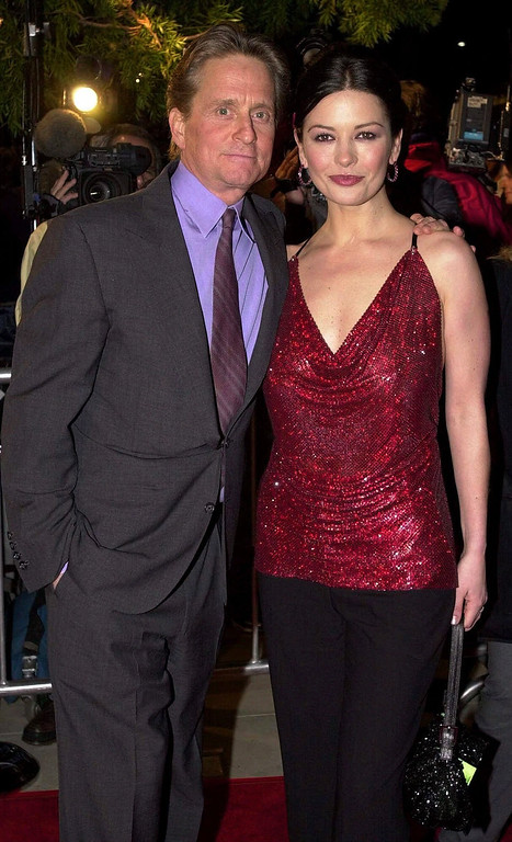 ". Actors Michael Douglas and Catherine Zeta-Jones arrive for the premiere of USA Films\' ""Traffic\"" in Beverly Hills, Calif., in this Dec. 14, 2000 photo.  (AP Photo/Michael Caulfield)"