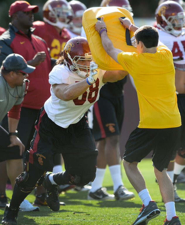 . USC linebacker J.R. Tavai sheds a blocking pad during drills at practice, Thursday, March 27, 2014, at USC. (Photo by Michael Owen Baker/L.A. Daily News)