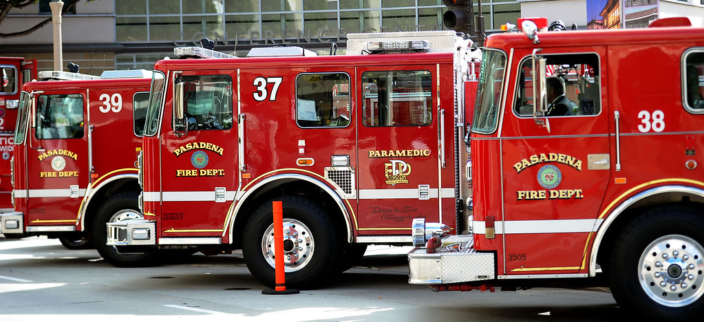 . Fire engines line Green Street during a celebration of life service for former Pasadena Fire dept. Capt. and California State fire marshall, John Tennant at the Pasadena Civic Auditorium in Pasadena, Calif., on Wednesday, Feb. 5, 2014. (Keith Birmingham Pasadena Star-News)