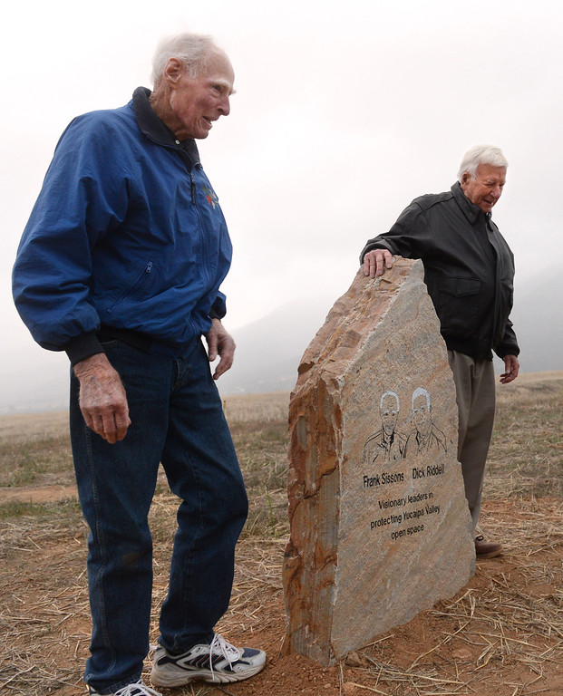 . Frank Sissons of the Yucaipa Valley Conservancy and Yucaipa councilmember Dick Riddell were honored with a stone monument during the dedication ceremony of El Dorado Ranch Park in Yucaipa, Thursday, Jan. 31, 2014. The city acquired 334 acre park off of Oak Glen Rd., from the Yucaipa Valley Conservancy with the requirement that land be a permanent open space. (John Valenzuela/Staff Photographer)