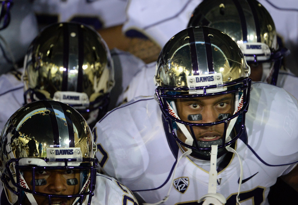 . Washington Huskies prepare to enter the field prior to their college football game against UCLA Bruins in the Rose Bowl in Pasadena, Calif., on Friday, Nov. 15, 2013.  UCLA won 41-31. 