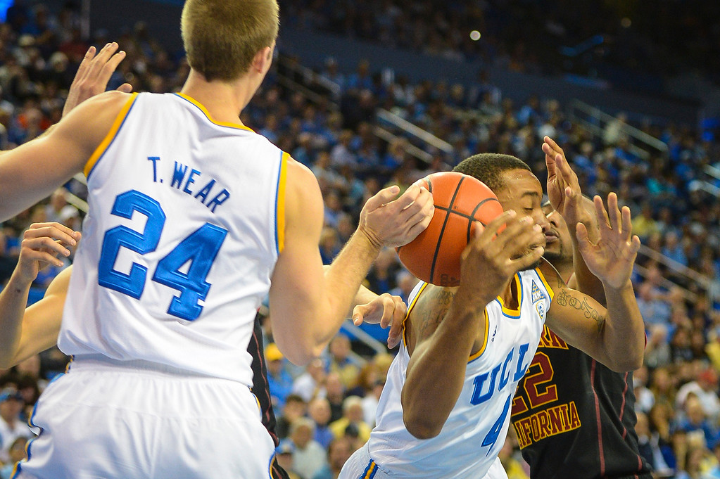 . UCLA�s Travis Wear and Norman Powell and USC�s Byron Wesley go after a rebound during game action at Pauley Pavilion Sunday, December 5, 2014. UCLA  defeated USC 107-73.  Photo by David Crane/Los Angeles Daily News.
