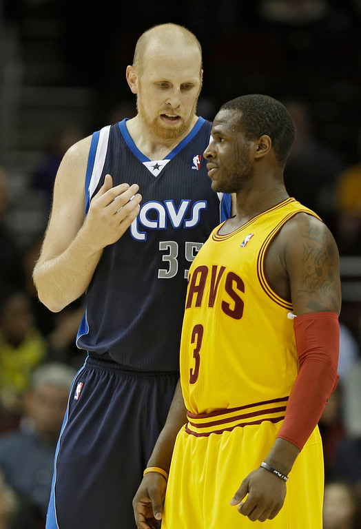 . Dallas Mavericks\' Chris Kaman, left, talks with Cleveland Cavaliers\' Dion Waiters (3) after the Maverick\'s 103-95 win in an NBA basketball game on Saturday, Nov. 17, 2012, in Cleveland. (AP Photo/Mark Duncan)