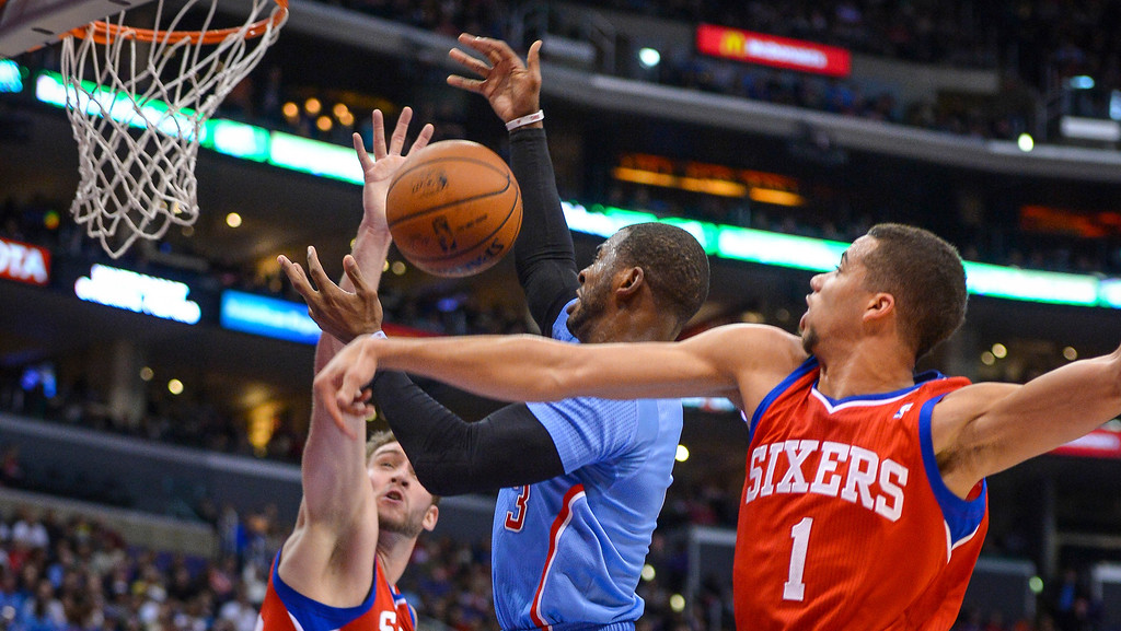 . Clippers� Chris Paul goes up against 76ers� Michael Carter-Williams and  Spencer Hawes for a rebound during first half action at Staples Center Sunday.  ( Photo by David Crane/Los Angeles Daily News )