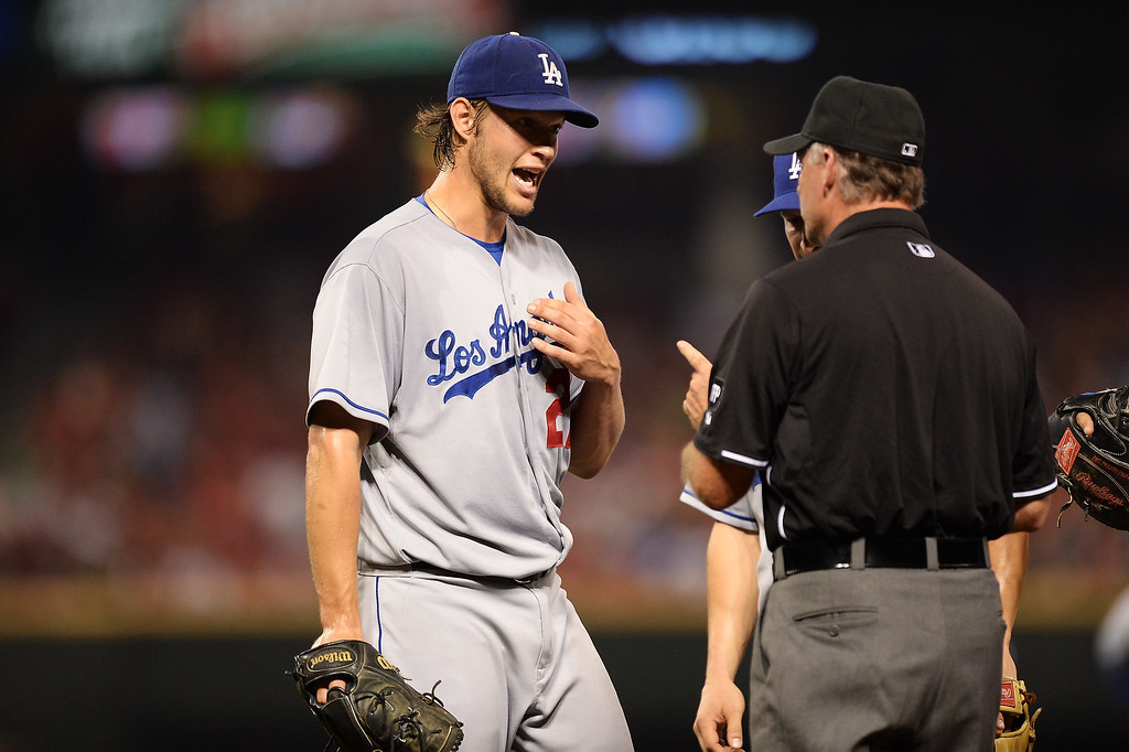 . CINCINNATI, OH - SEPTEMBER 8:  Pitcher Clayton Kershaw #22 of the Los Angeles Dodgers talks with first base umpire Ed Hickox after Hickox called Kershaw for a balk in the third inning against the Cincinnati Reds at Great American Ball Park on September 8, 2013 in Cincinnati, Ohio. Cincinnati defeated Los Angeles 3-2 to sweep the series.  (Photo by Jamie Sabau/Getty Images)