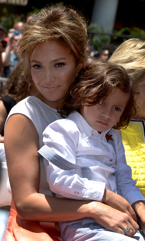 . US actress, singer Jennifer Lopez (L) holds son Max Anthony (R) during her star ceremony on the Hollywood Walk of Fame in Hollywood, California, USA 20 June 2013. Lopez was awarded the 2,500th star on the Hollywood Walk of Fame in the category of Recording.  EPA/PAUL BUCK