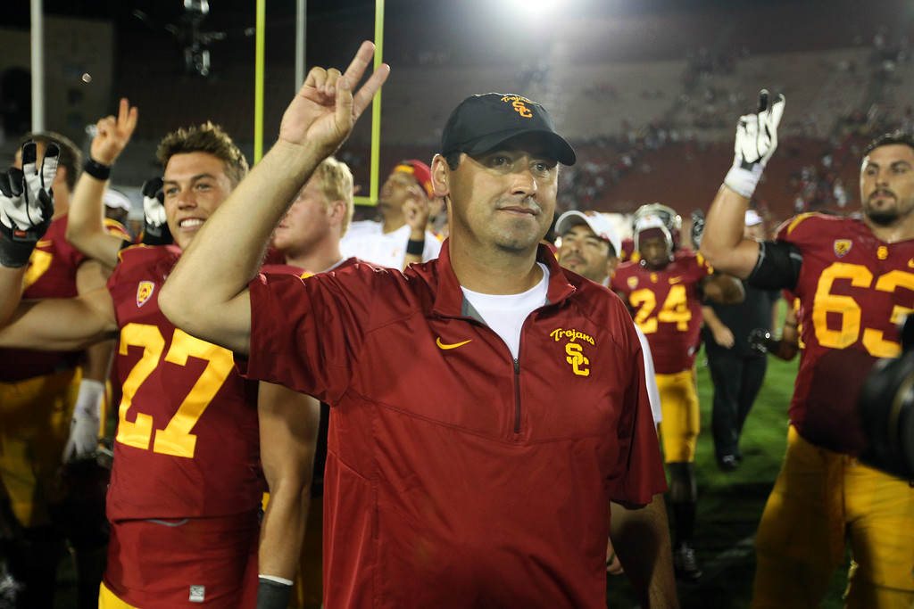 . USC head coach Steve Sarkisian salutes the USC students after beating Fresno State 52-13, Saturday, August 30, 2014, at the L.A. Memorial Coliseum. (Photo by Michael Owen Baker/Los Angeles Daily News)