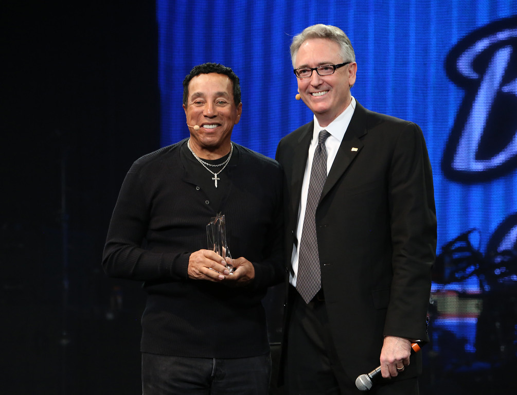 . ANAHEIM, CA - JANUARY 23:  Singer/Songwriter Smokey Robinson and NAMM President and CEO Joe Lamond attends the 2014 National Association of Music Merchants show media preview day at the Anaheim Convention Center on January 23, 2014 in Anaheim, California.  (Photo by Jesse Grant/Getty Images for NAMM)