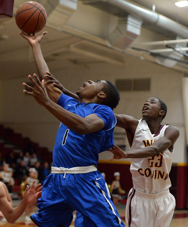 . Diamond Ranch\'s Ernest Ugoagu (1) drives to the basket past West Covina\'s Nick Hart (23) in the first half of a prep basketball game at West Covina High School in West Covina, Calif., on Wednesday, Jan. 8, 2014. (Keith Birmingham Pasadena Star-News)