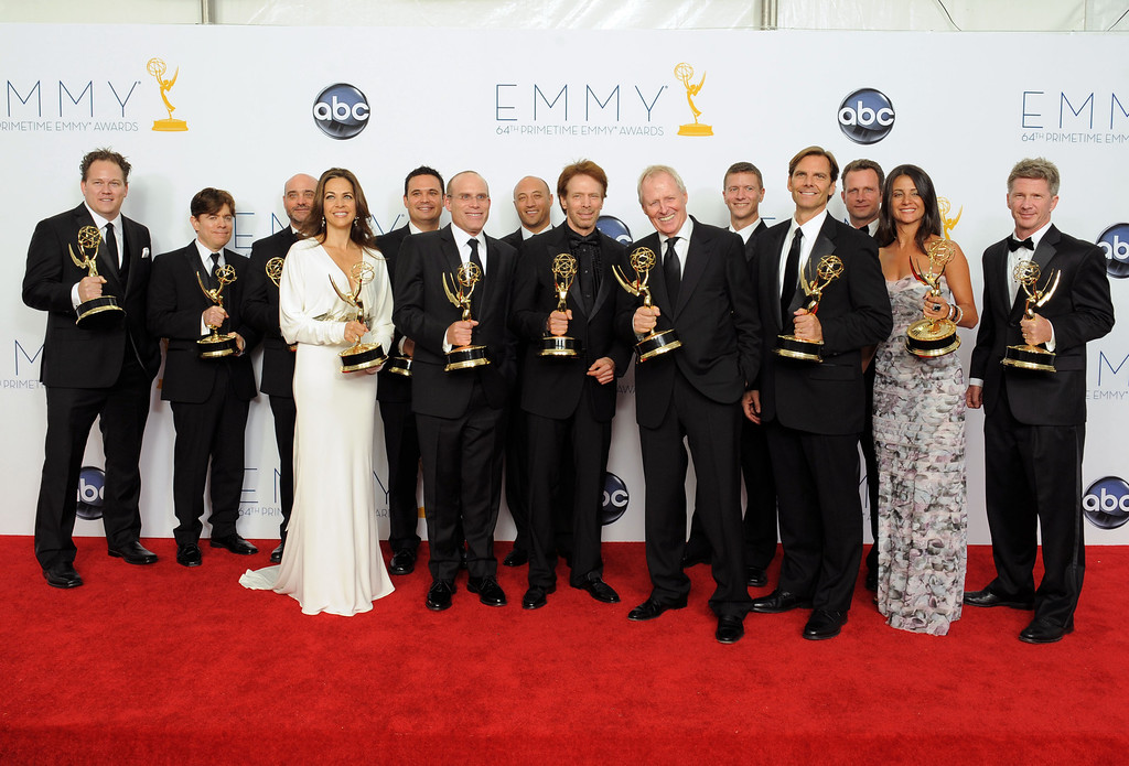 """. Producer Jerry Bruckheimer, center, winner Outstanding Reality-Competition Program for \""""The Amazing Race\"""", poses backstage at the 64th Primetime Emmy Awards at the Nokia Theatre on Sunday, Sept. 23, 2012, in Los Angeles. (Photo by Jordan Strauss/Invision/AP)"""