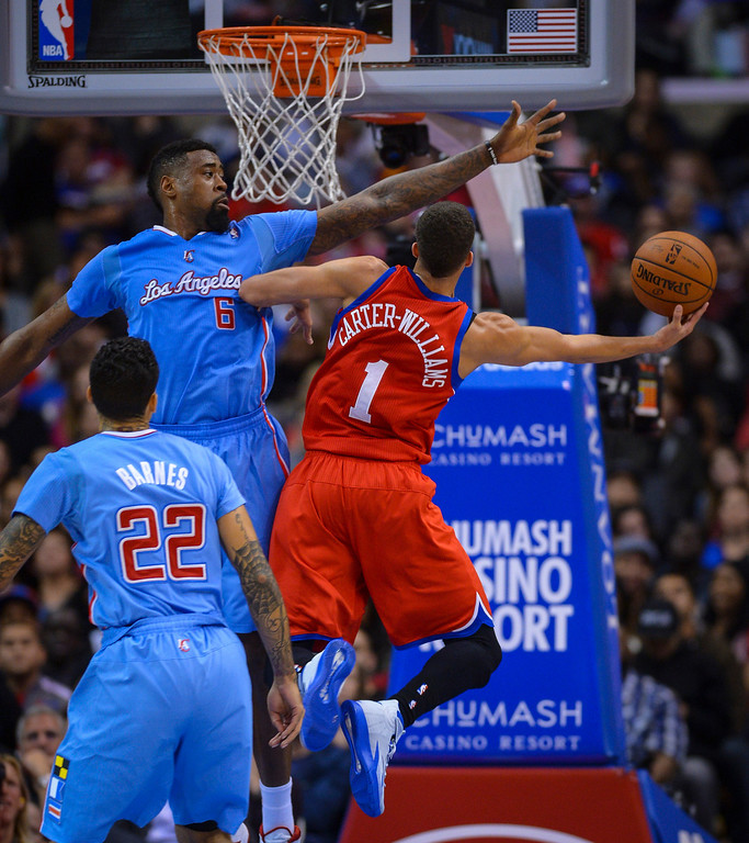 . 76ers� Michael Carter-Williams tries to find a shot around Clippers� DeAndre Jordan at Staples Center Sunday.  The Clippers defeated the 76ers 124-78.  ( Photo by David Crane/Los Angeles Daily News )