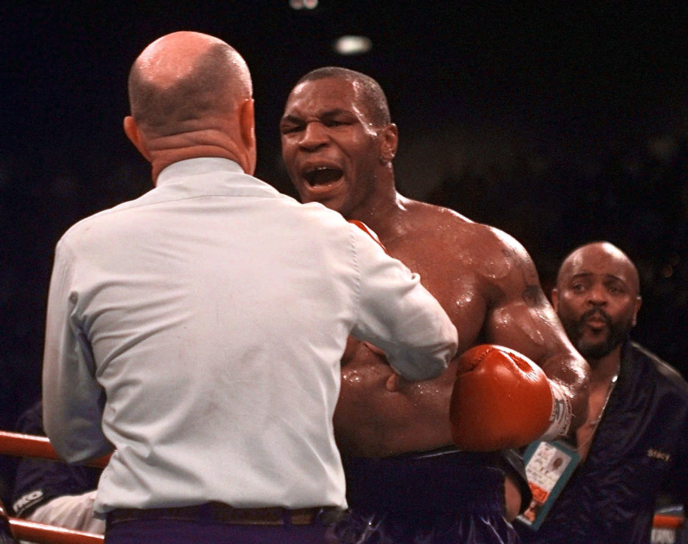 . Mike Tyson reacts to referee Mills Lane after Lane stopped the fight against Evander Holyfield in the third round of their WBA Heavyweight match after Tyson bit Holyfield\'s ear for the second time Saturday, June 28, 1997, at the MGM Grand in Las Vegas. Holyfield retained his title. (AP Photo/Lenny Ignelzi)