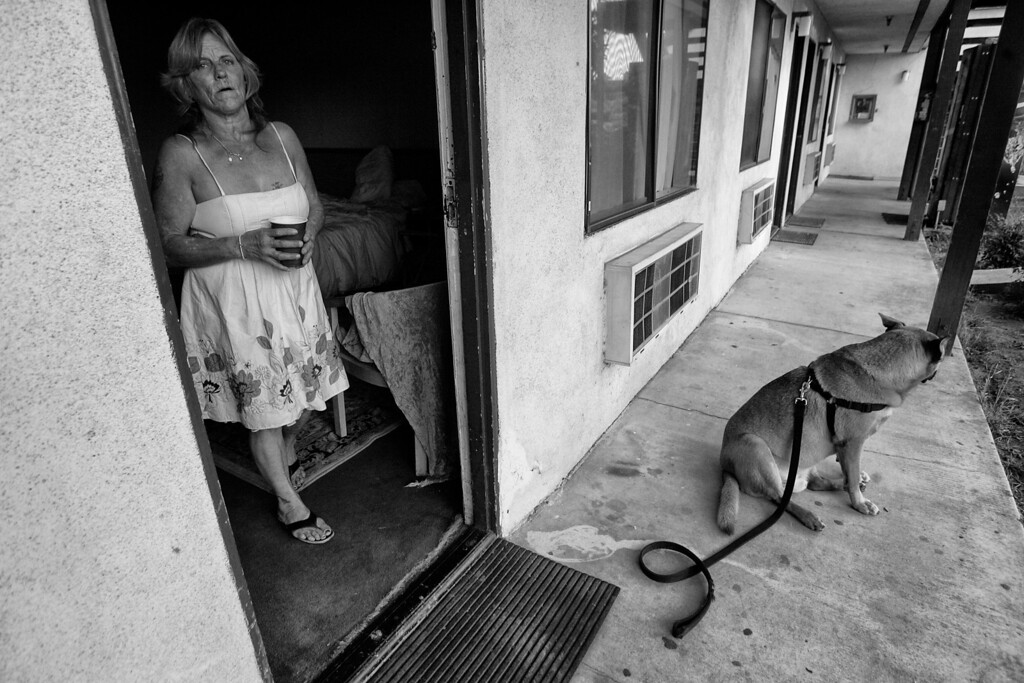 . Dorothy and Gunner live on the bottom floor of a one-room motel.