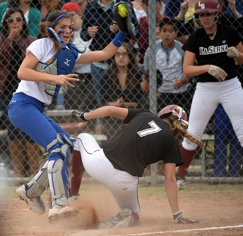 . La Serna\'s Liz Brautigam (7) scores past Bishop Amat catcher Julia Valenzuela in the second inning of a prep playoff softball game at Bishop Amat High School in La Puente, Calif., on Thursday, May 22, 2014. La Serna won 6-0.   (Keith Birmingham/Pasadena Star-News)